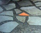 River pebble and tinted concrete mosaic