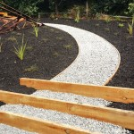Rustic totara and pebble path