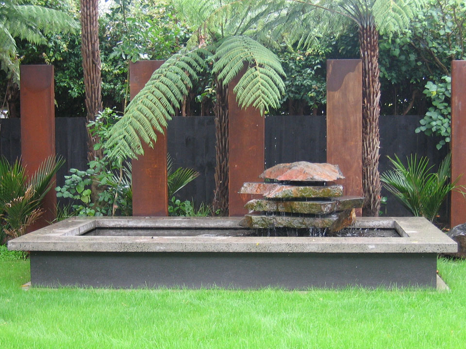 Contemporary Water Feature With Cut Natural Stone Detail