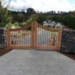 Timber & steel gate, rock wall