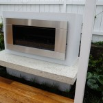 Gas fire with polished concrete hearth