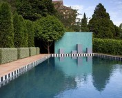 Pool with tiled surround and chequerboard waterline tile
